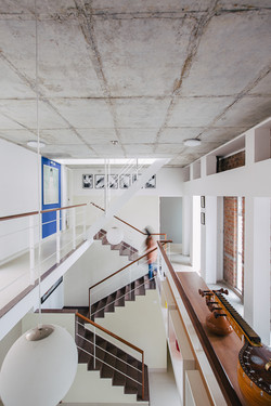 Exposed concrete finish of the ceiling as it hovers over the entire space