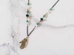 Brass hand necklace, green gemstones