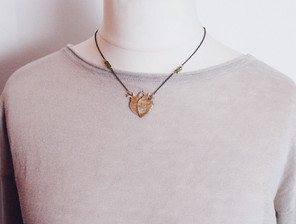 Double heart necklace worn