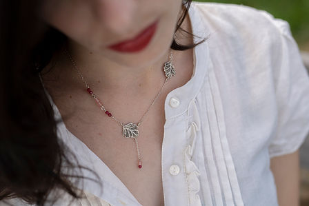 Sycamore leaf necklace in sterling silver, roots of ruby and pink glass