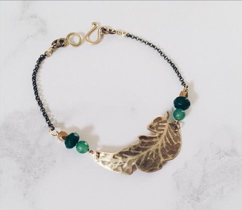 Banana leaf bracelet, brass + green gemstones