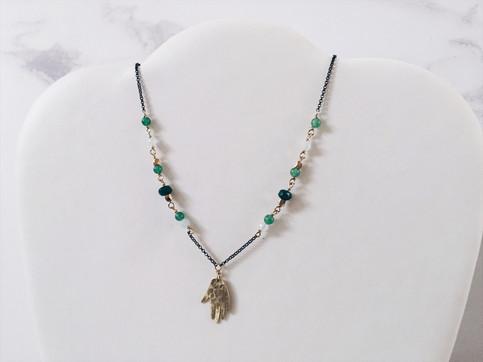 Brass hand necklace, green gemstones