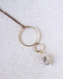 Double circles necklaces, brass + quartz