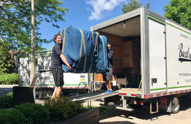 Todd and Dom loading a sofa