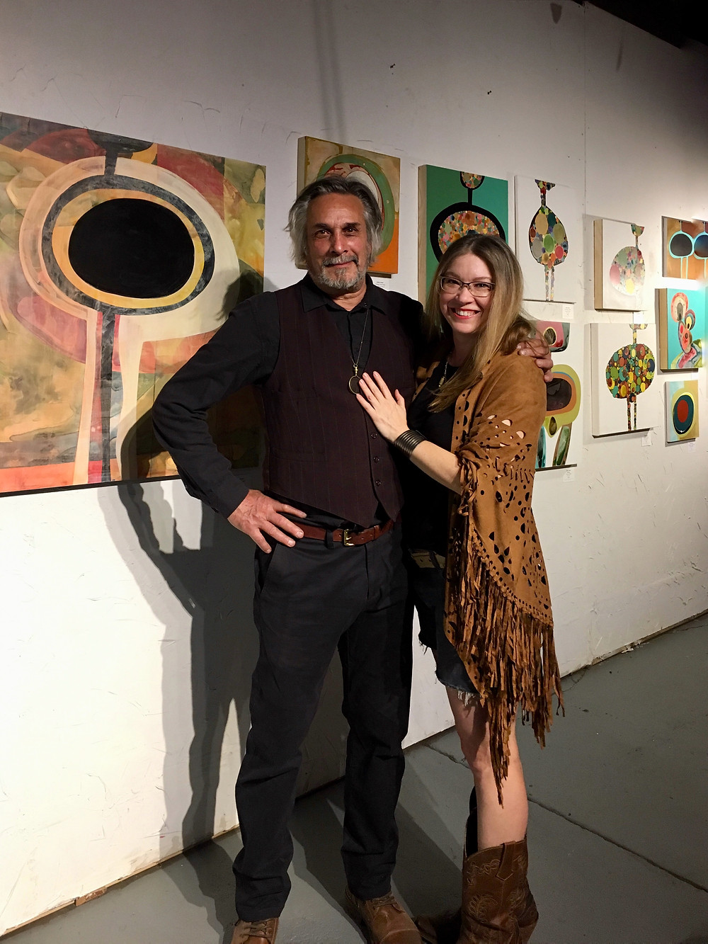 Sculptor Sean Guerrero and Painter Robin Arthur at an exhibition of her abstract paintings