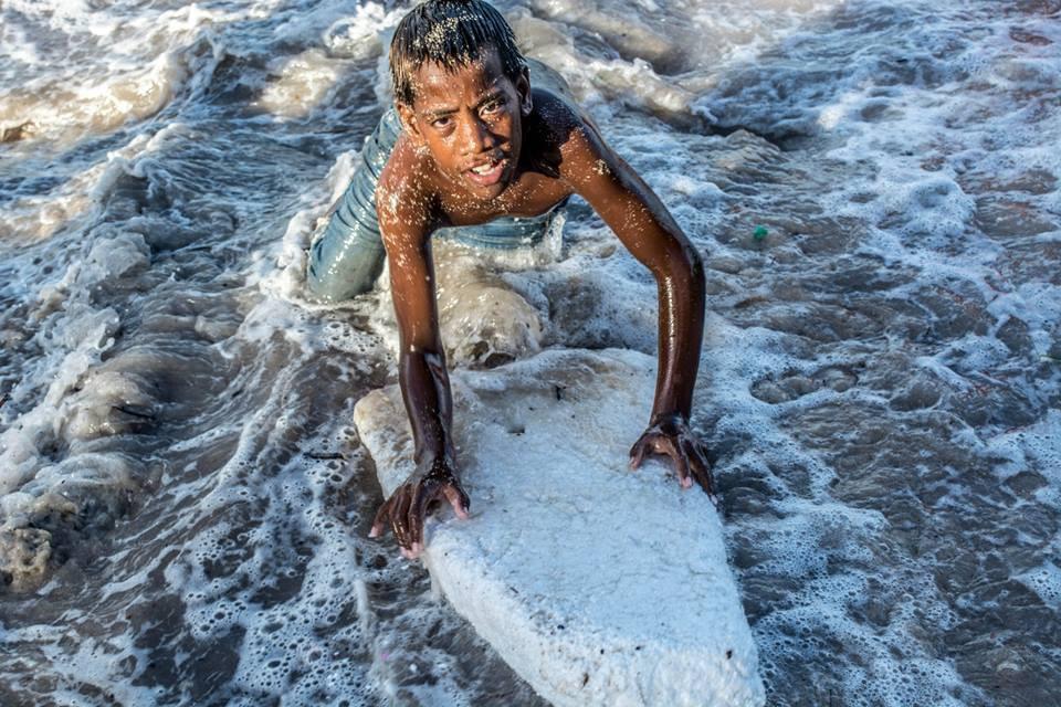 Kid playing in the lagoon Tarawa.jpg