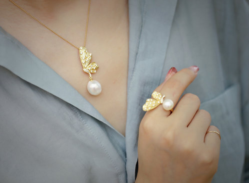 Butterfly pearl ring & pendant set.