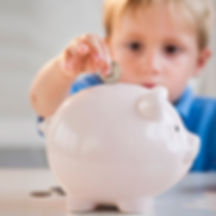 boy-with-piggy-bank-teaching-kids-about-money-pg-full.jpg