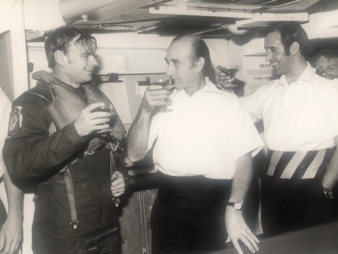 Lt Jim Porter USN being congratulated by Capt Ted Anson
