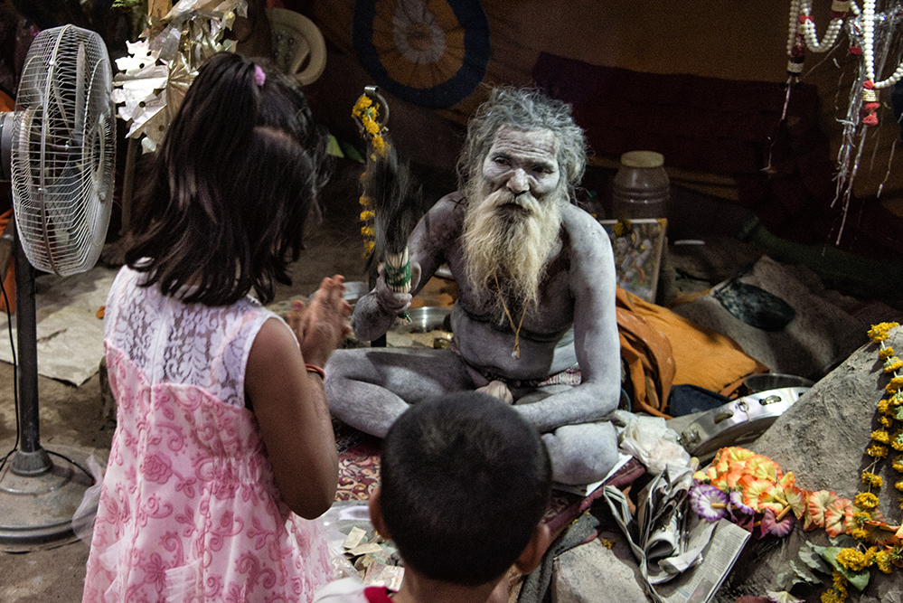 Baba Blessing two children