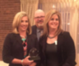 Rizzolino, Riker & Scarborough with Award
