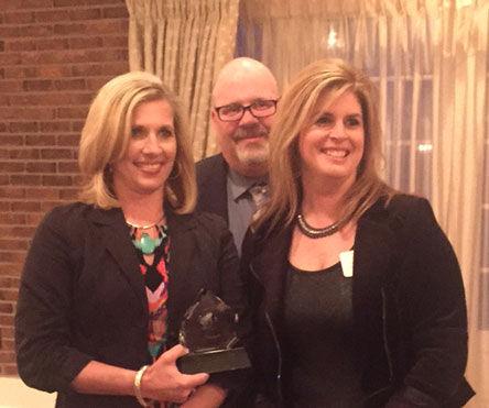 Mrs. Rizzolino, Dr. Riker & Mrs. Marouchoc with Award