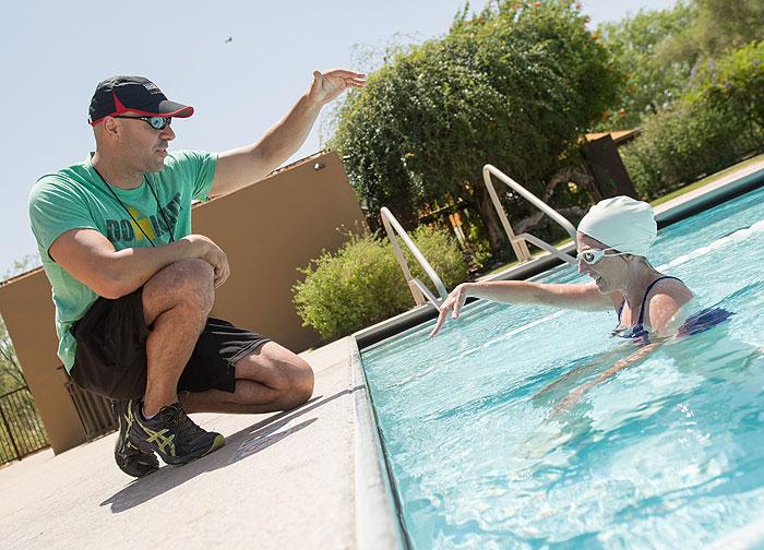 Ramsey Bergeron coaching swimming