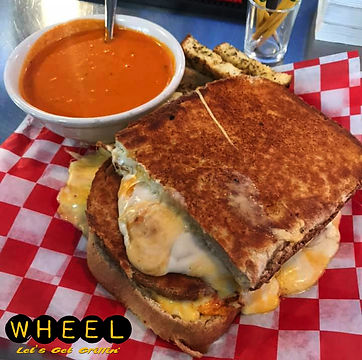 Grilled Cheese Challenge $18   XL Grilled Cheese with (6) different types of cheese on 12 inch homemade white bread.  Served with a bowl of tomato bisque and croutons.  Eat it all within 30 minutes and its on us- PLUS you win a WHEEL t-shirt!