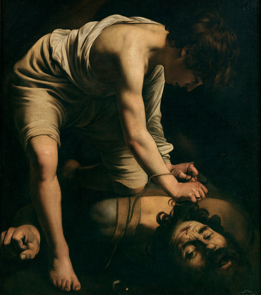 David and Goliath (or David with the Head of Goliath or David Victorious over Goliath) is a painting by the Italian Baroque master Caravaggio (1571–1610). It was painted in about 1599, and is held in the Museo del Prado, Madrid. Two later versions of the same theme are currently to be seen in Kunsthistorisches Museum, Vienna (David with the Head of Goliath), and in Rome's Galleria Borghese (David with the Head of Goliath).  The David and Goliath in the Prado was painted in the early part of the artist's career, while he was a member of the household of Cardinal Francesco Maria Del Monte. It shows the Biblical David as a young boy (in accordance with the Bible story) fastening the head of the champion of the Philistines, the giant Goliath, by the hair. The light catches on David's leg, arm and flank, on the massive shoulders from which Goliath's head has been severed, and on the head itself, but everything else is dark. Even David's face is almost invisible in the shadows. A wound on Goliath's forehead shows where he has been felled by the stone from David's sling. The overwhelming impression is of some action intensely personal and private - no triumph, no armies, no victory.  Caravaggio originally showed Goliath's face fixed in wild-eyed open-mouthed terror, tongue rolling, eyeballs swivelled to the edges of the sockets. In the finished painting the melodrama is banished: the drama is transferred from Goliath to the quietly efficient David, his face almost hidden, intent on his work with his hands in his enemy's hair, kneeling almost casually on the man's torso.  This painting and two others done at about the same time – the first version of Sacrifice of Isaac and the first John the Baptist – were taken to Spain shortly after they were made, where they were frequently copied and made a deep impression on art in that country.