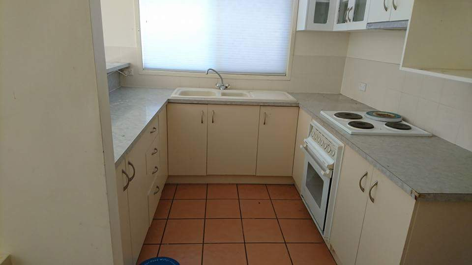 Before: kitchen with terracotta tile