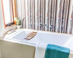 bath tub with bold wall tile