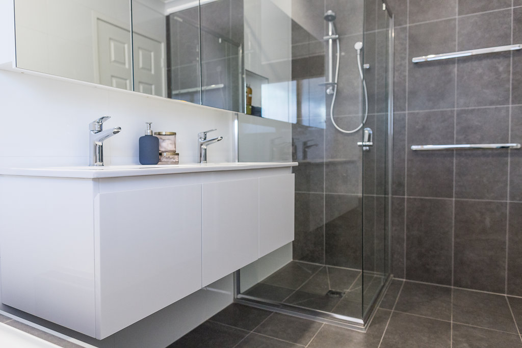 Vanity, shower and towel rails