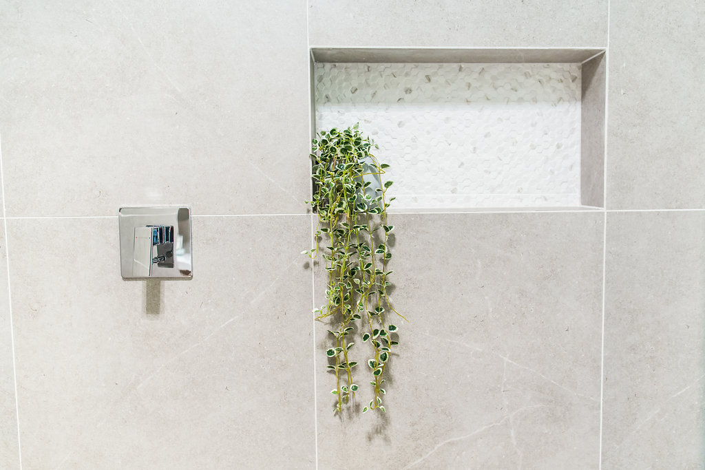 shower with plant in niche