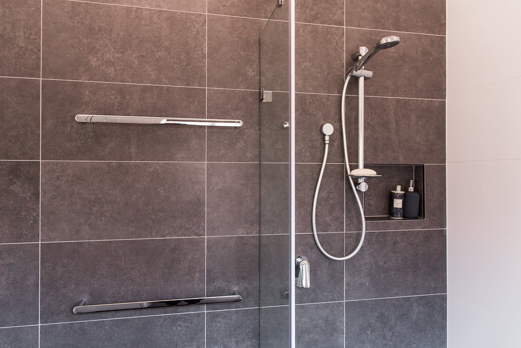 Shower on rail with dual towel rail