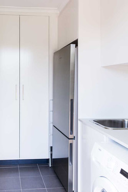 Laundry with fridge and pantry