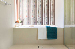 Bath with feature tile wall