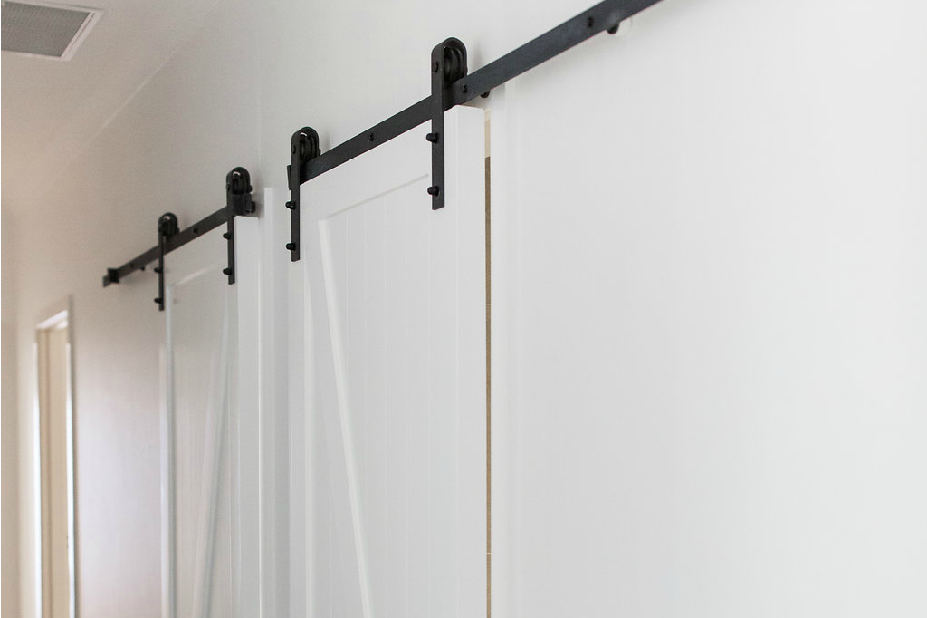 Barn doors on exposed rail