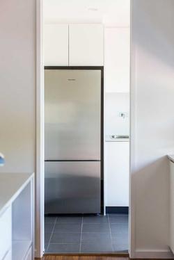 Fridge and overhead cabinets