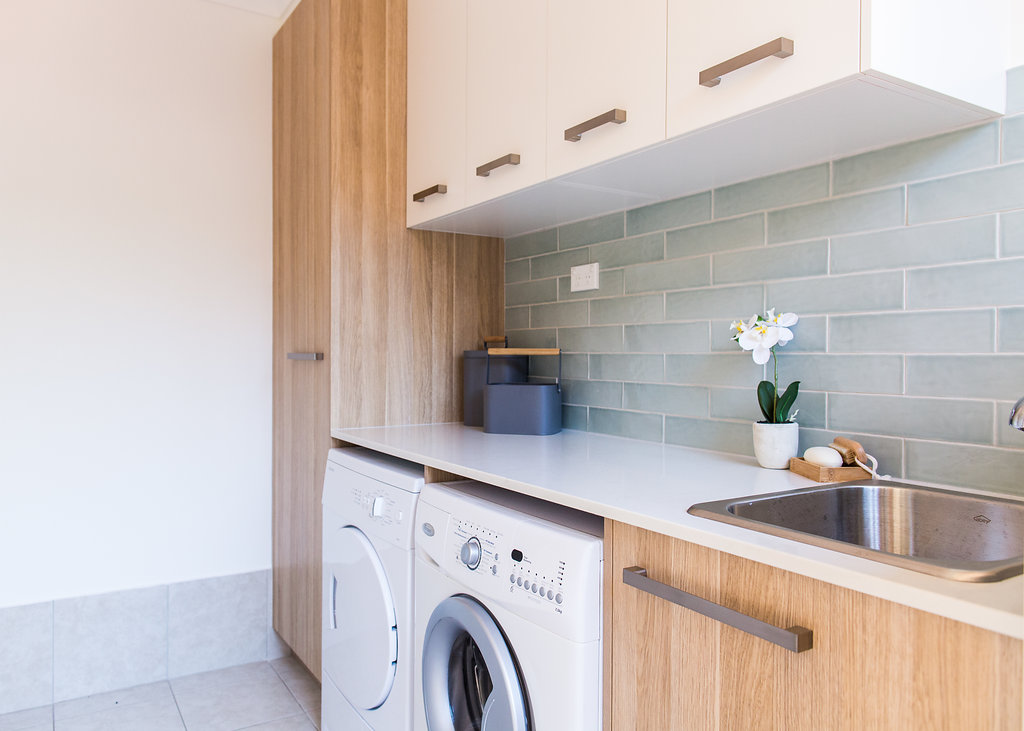 Laundry Benchtop and broom cupboard