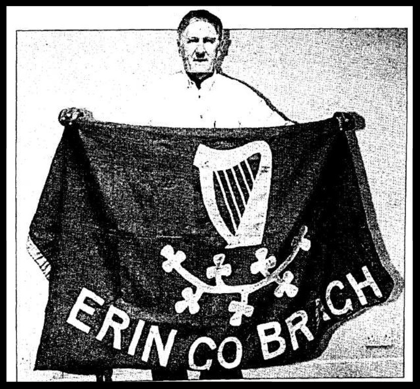 Fintan Walsh holding the flag unfurled by Peter O'Connor in 1906
