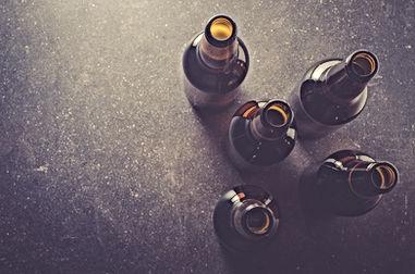Beer bottles on dark table.jpg