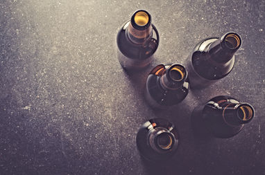Beer bottles on dark table.jpg