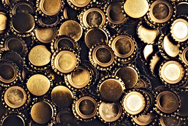 Beer bottle caps piled.jpg