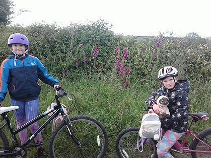 Emily & Sarah cycling.jpg
