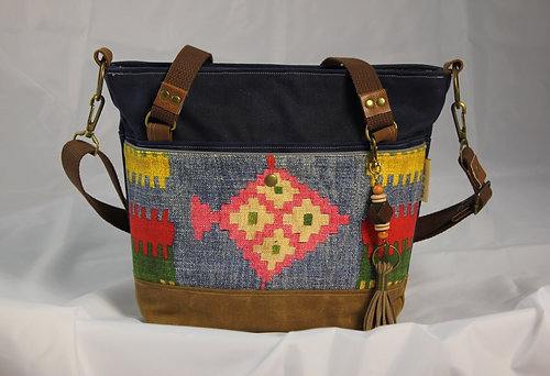 1 25 Inch Wide Strap In Dark Brown Heavy Weight Cotton Canvas Webbing That Adjusts To Crossbody Or Shoulder Length And Soft Arm Handles Made From