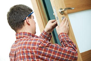 Male handyman carpenter at interior wood