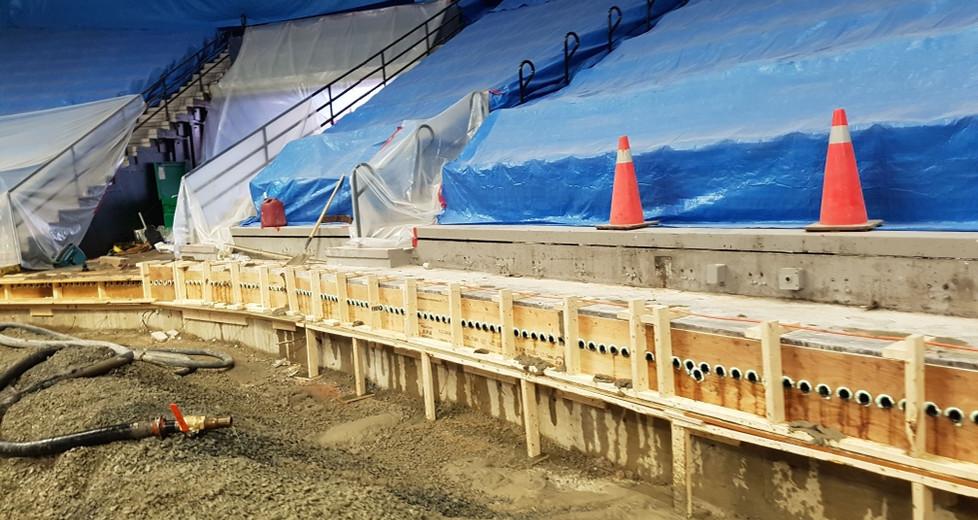 Rink cooling sytem concrete bulkhead