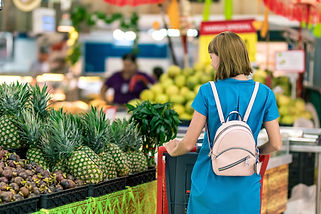 woman-standing-beside-pineapple-fruits-2