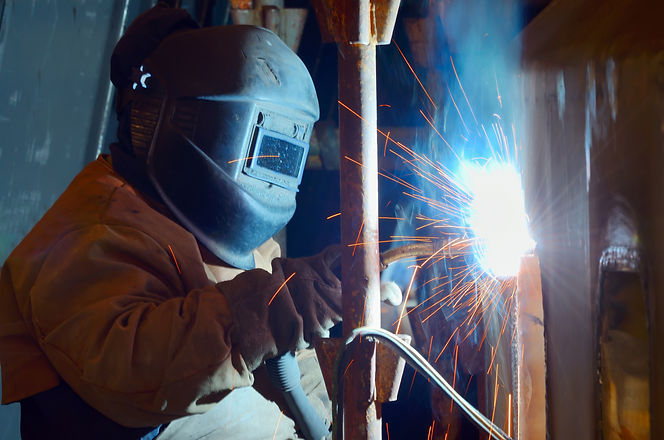 a welder working at shipyard in day time
