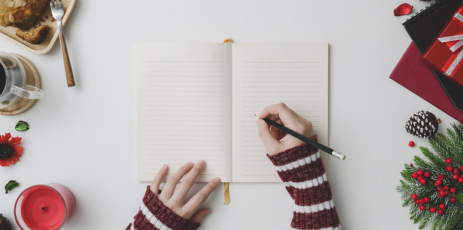 Canva - Person Writing on Notebook (1).j