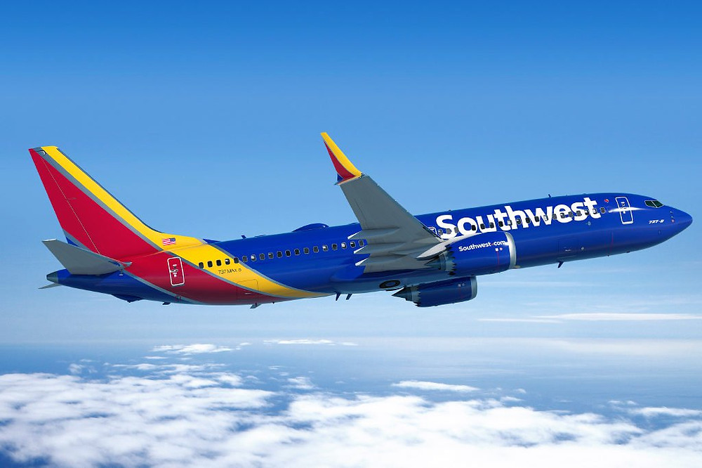 Southwest airplane flying above the clouds