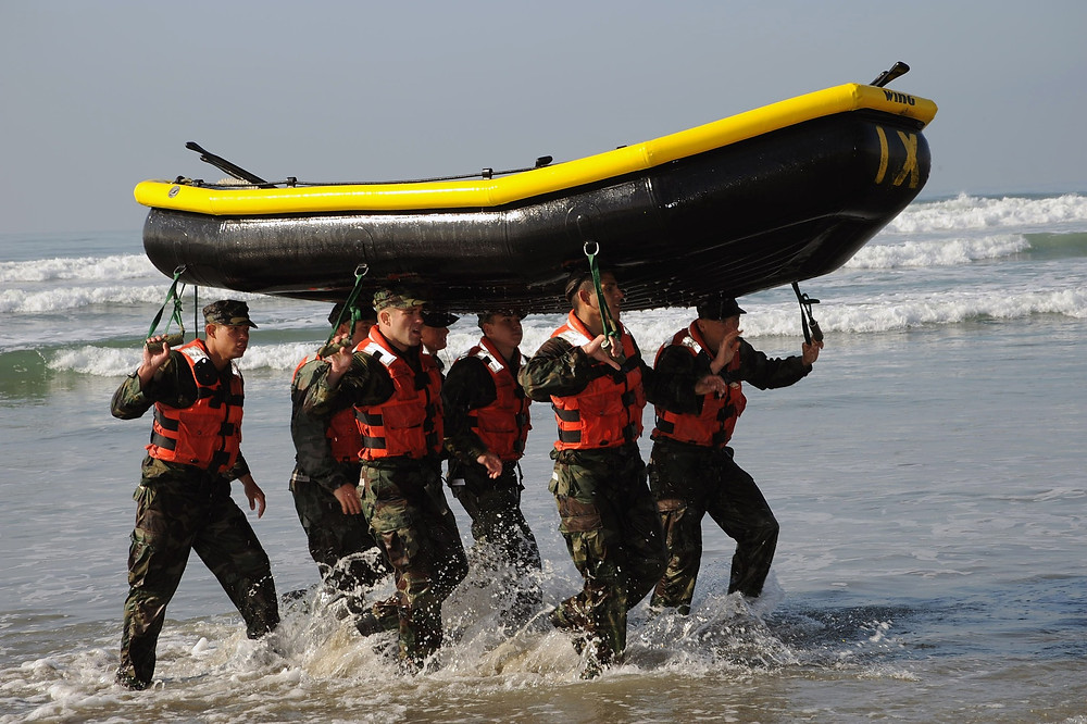 Military team training with boat