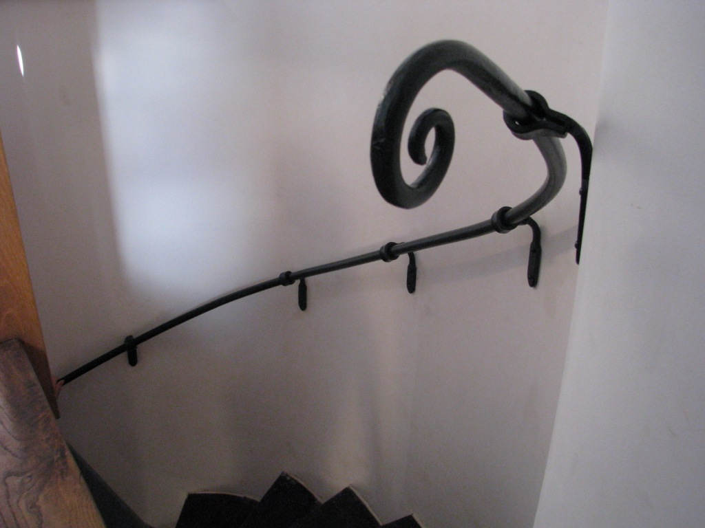 Forged helical hand rail scroll