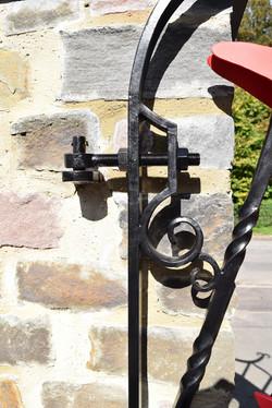 Dragon Gates hinge scroll detail