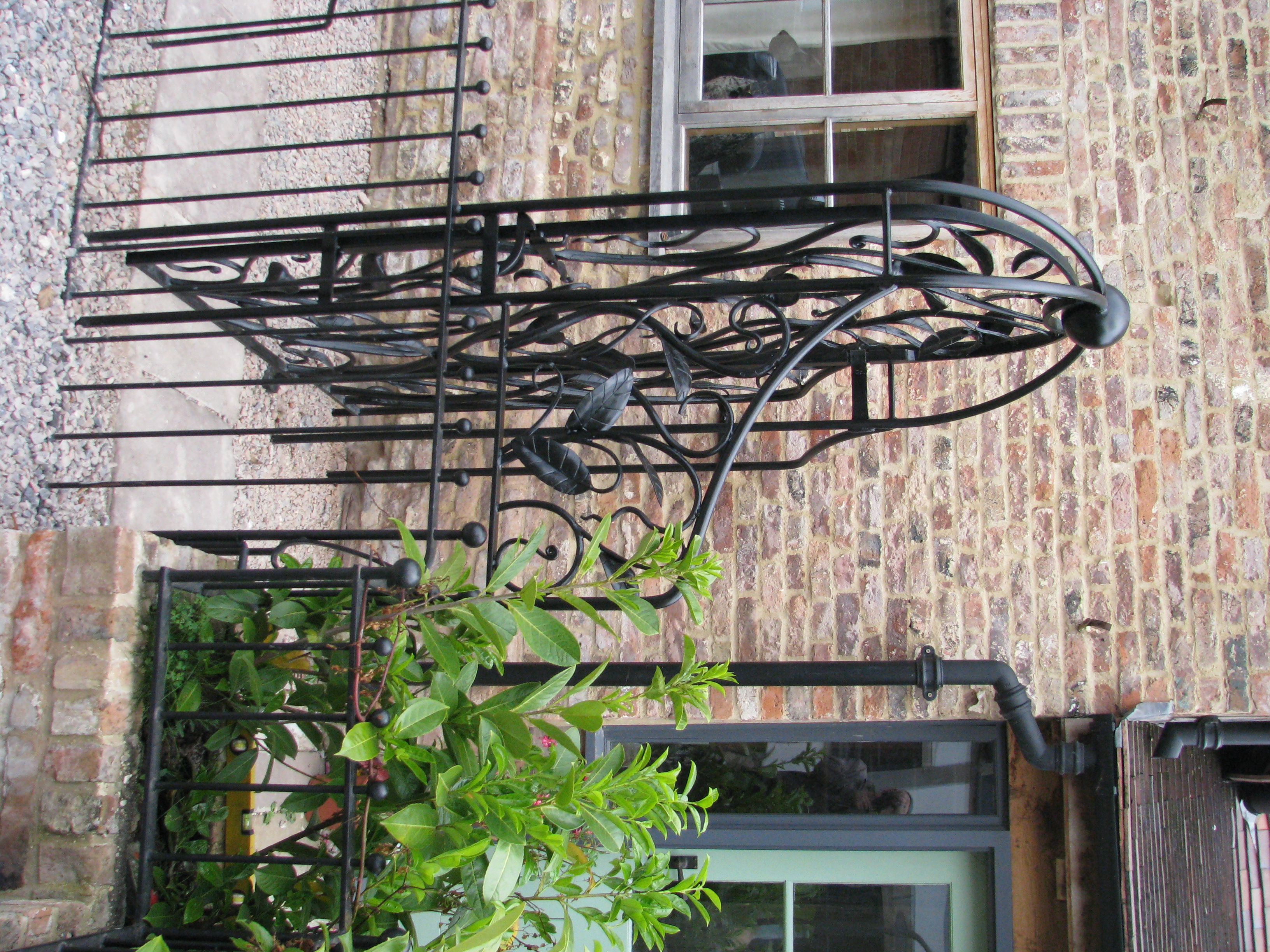 Forged leaf garden gate side
