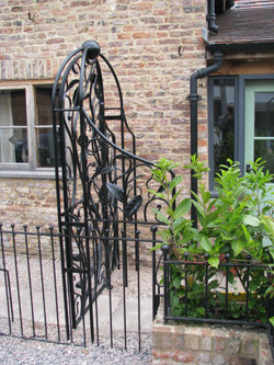 Forged leaf garden gate side