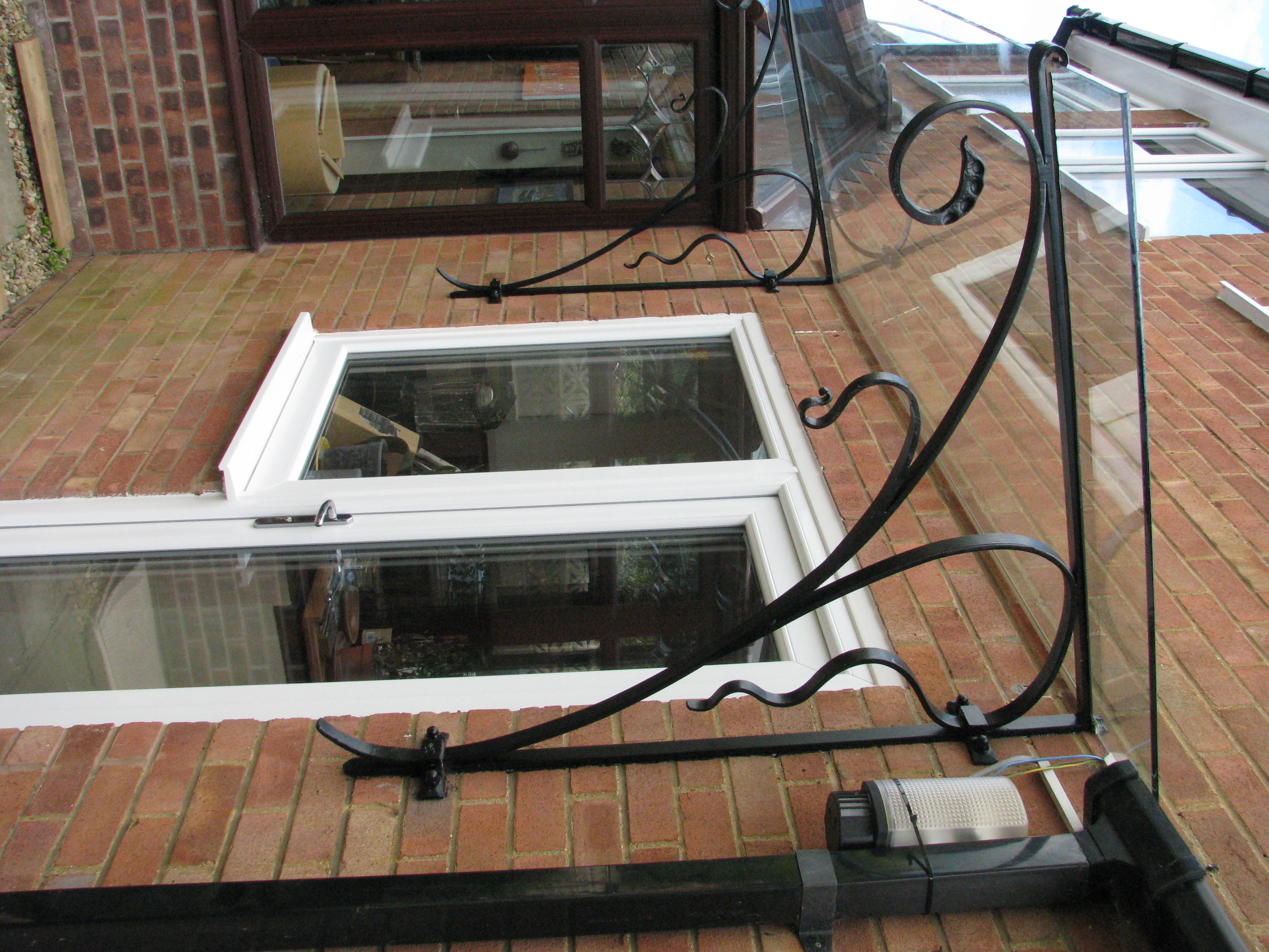 Decorative forged  brackets for glass porch