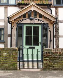 Blacskmith forged archway gate