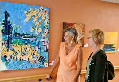 Isabelle Alzaldo, Artist showing her artwork to a perspective client.