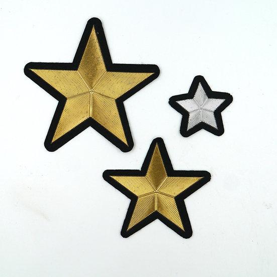 Metallic Star Motifs on Black Backing